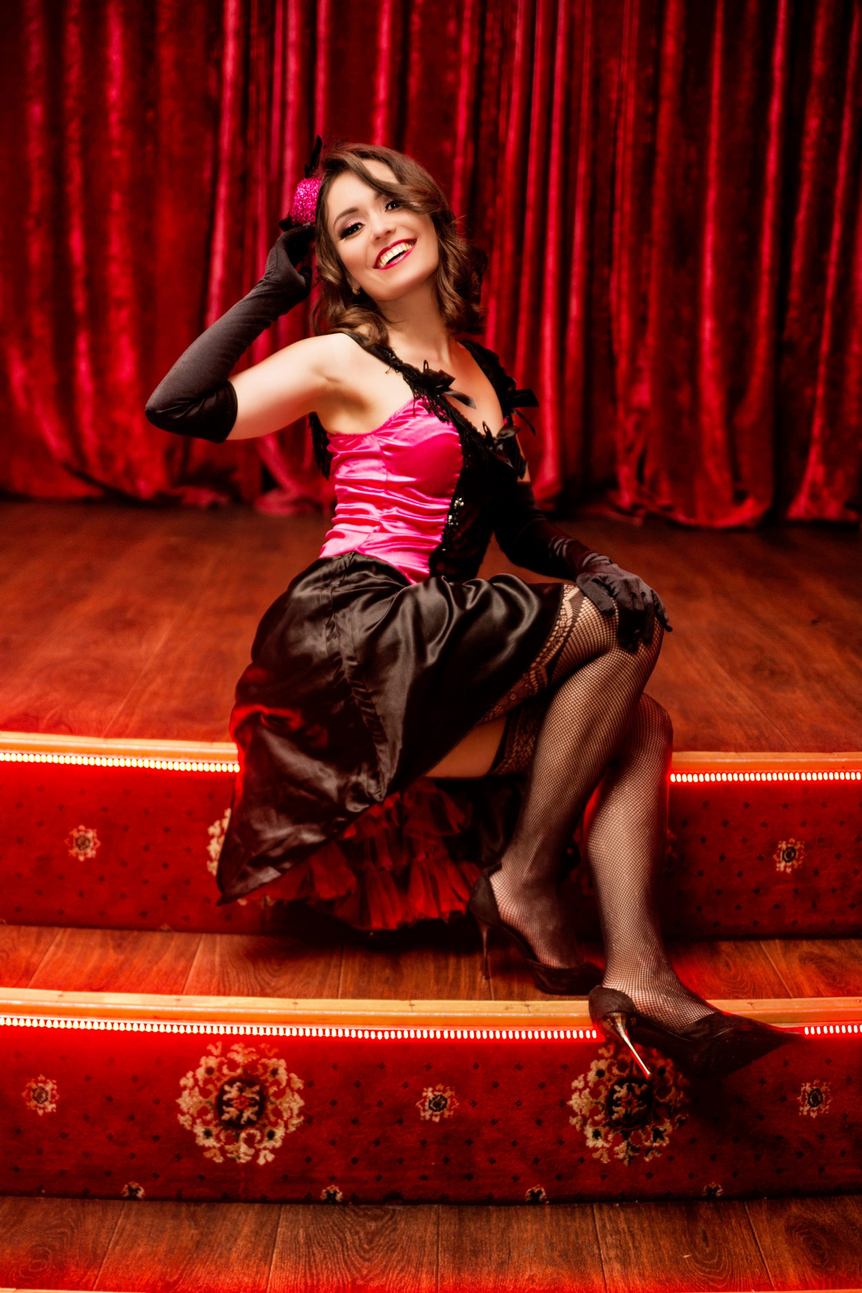 photo of Elegant dancer in moulin rouge style on the stage