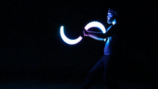 Flow arts performer Sh8peshifter dances with LED S-staves